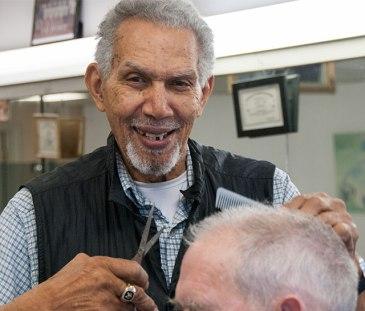 Caption: Ken Norton gave one of his last haircuts Thursday at Raeford's Barber Shop. (David Boraks/DavidsonNews.net)