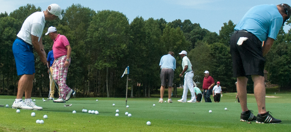 Pros and amateurs practiced putting during last year's tournament at River Run. (David Boraks/DavidsonNews.net)
