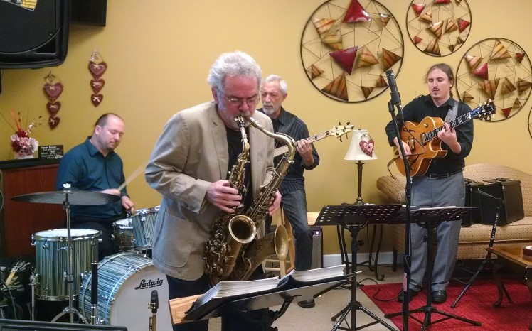 John Alexander played two saxophones at Heart 2 Heart Bakery in Cornelius on Sept. 27 with his band, Big Octave. From left are drummer Chris Garges, Alexander, bassist Ron Brendle and guitarist Troy Conn. (David Boraks photo)