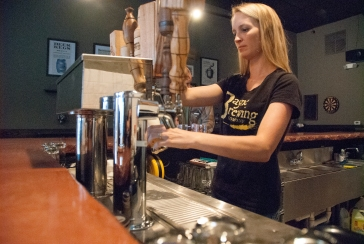 Kelly Bayne poured samples of beer at Bayne Brewing in Cornelius. (David Boraks photo)