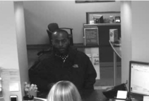 Security camera photo shows suspect at the Wells Fargo in Davidson. (Davidson Police Department)