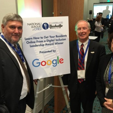 E2D President Pat Millen (left), Davidson Mayor John Woods and E2D board member Lisa Combs accepted the award at the National League of Cities meeting in Nashville Nov. 5.