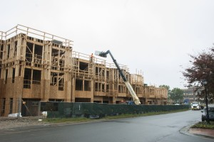 The Linden, with 154 apartments, is going up on Jetton Street near the Harris Teeter in Davidson. (David Boraks photo)