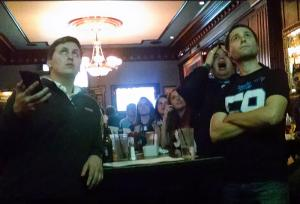 Fans showed concern as they watched the Panthers and Broncos at Ri-Ra on Tryon Street. (David Boraks/WFAE)