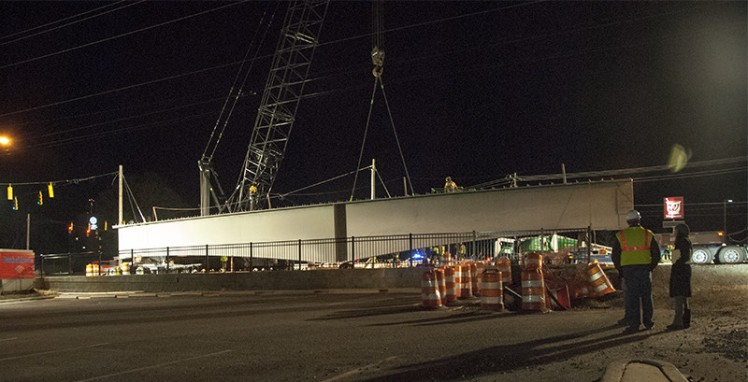 Workers prepared to move a girder Thursday night, Feb. 12, 2016, on the Blue Line extension at Harris Boulevard and North Tryon Street. (David Boraks photo)