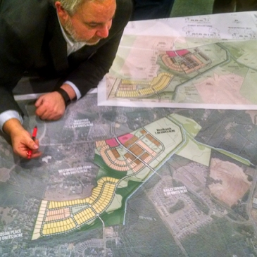 Senior Planner Chad Hall with the Town of Davidson listened to residents' comments about the proposed West Branch project Monday. (David Boraks photo)