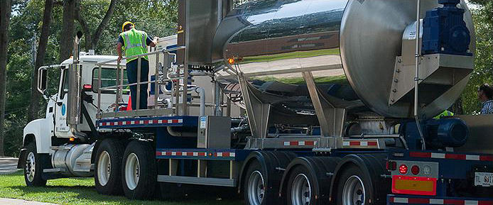 """A large truck with an onboard ice maker is used to create the """"ice pig."""" (Utility Services Corp.)"""