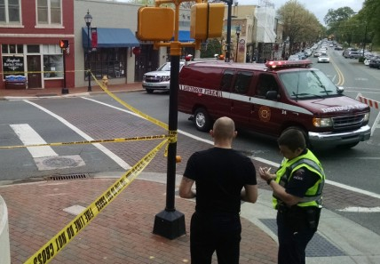 The accident happened in this crosswalk, between Flatiron Kitchen and Raeford's Barber Shop.