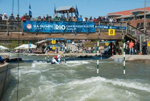 Fans watched a canoe race from above at the Olympic Trials at the whitewater center in Charlotte (David Boraks/WFAE)