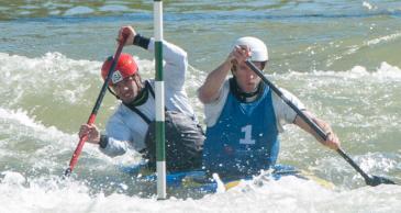 Casey Eichfeld (left) and Devin McEwan topped the men's double canoe. (David Boraks/WFAE)