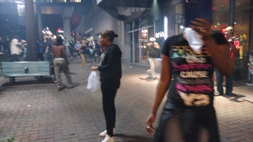 8:40pm: Tear gas sent people running away from the Omni. (David Boraks/WFAE)