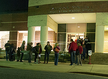 Citizens lined up to vote at Town Hall on election night a few years back. (David Boraks photo)