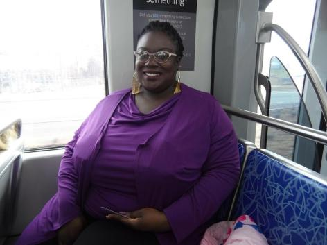 Alexis Cureton says the new light rail extension will cut her 2 hour commute in half. (David Boraks/WFAE)