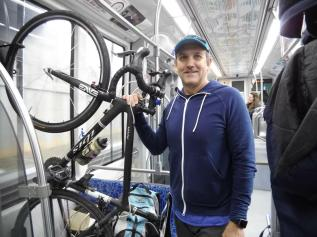 Paul Wood carried his bike onto the train for a test run. (David Boraks/WFAE)